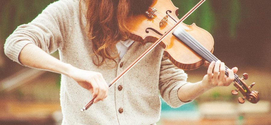 showing slow living hobby - learning an instrument, the violin